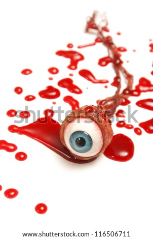 A realistic looking eyeball in a pool of blood over a white background.
