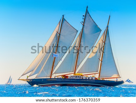 A really big 3 mast old classic wooden sailing boat during a Classic Boats Regatta in Spetses island in Greece - stock photo