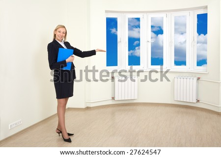 A realtor is showing around a new house - stock photo