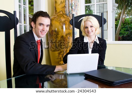 a realtor meets with a client at home, painting on vase is ancient chinese art not copyright - stock photo