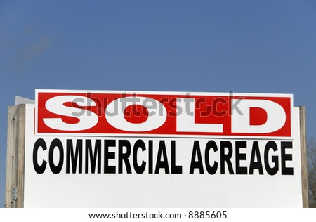 A realtor SOLD Sign on commercial property - stock photo