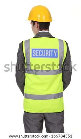 A rear view of a security guard, isolated on white