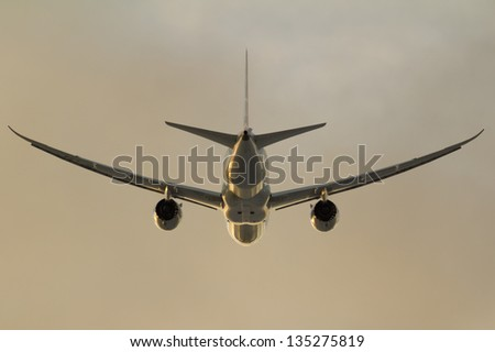 A rear view of plane taking off - stock photo
