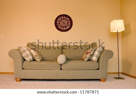 A reception area where guests sit in the comfy couch - stock photo