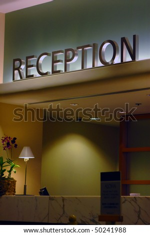 A reception desk at a modern hotel - stock photo