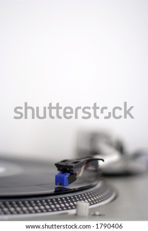 a record turntable with the needle in focus - stock photo