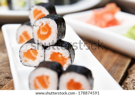 A rectangular plate with gourmet sushi
