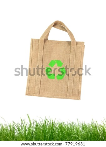 A recycle shopping bagisolated against a white background - stock photo
