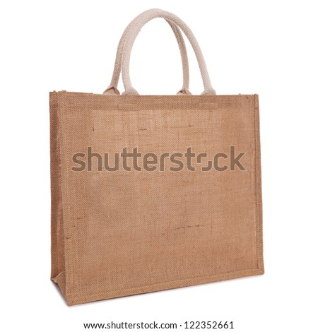 A recycled hessian or jute shopping bag isolated on white background. - stock photo