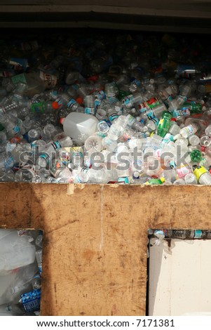 a recycling station filled with recycled empty plastic bottles - stock photo