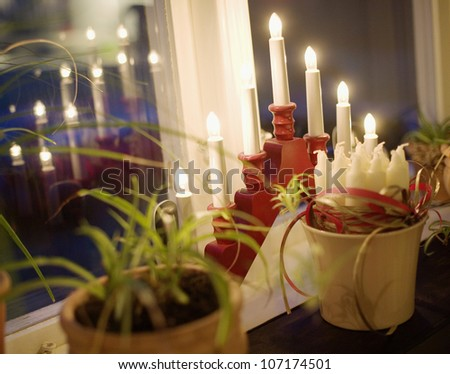 A red Advent candlestick, Sweden.