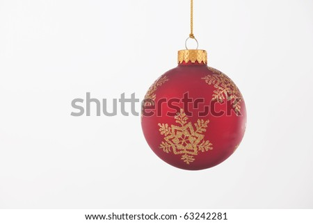 A red and gold Christmas ornament isolated against a white background.