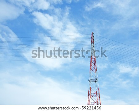 A red and white tower supporting power lines - stock photo