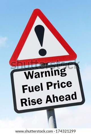 A red and white triangular road sign with a warning about a fuel price rise concept. .  - stock photo