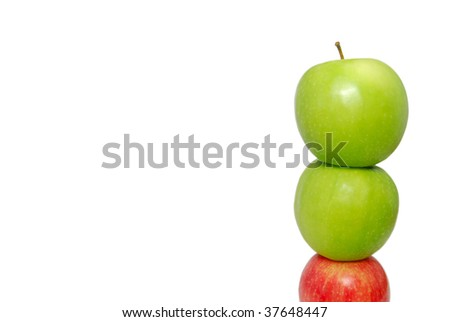 A red apple at the bottom of the pile supporting other apples. Suitable for concepts such as outstanding, leadership, individualistic, success, daring to be different, support and help, - stock photo