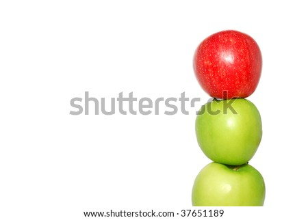A red apple at the top of a pile of apples.Suitable for concepts and ideas such as outstanding, leadership, individualistic, success, daring to be different, and reaching for the top - stock photo