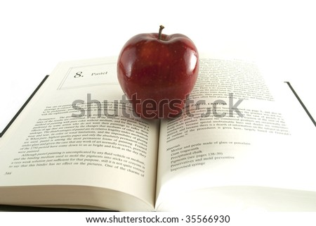 A red apple on a book - stock photo