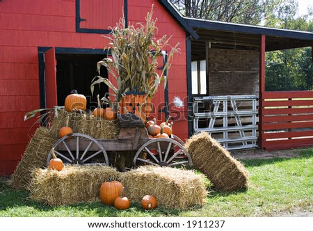 A red barn decorated for fall and halloween and thanksgiving. - stock photo