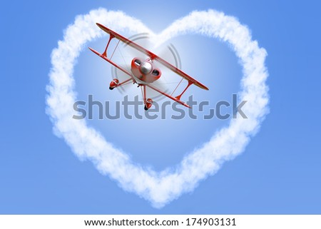 A red biplane creating a heart shaped cloud in a bright blue sky.  - stock photo