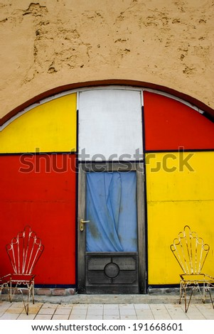 A red, blue, and yellow colorful doorway of a storefront in the Caribbean. - stock photo