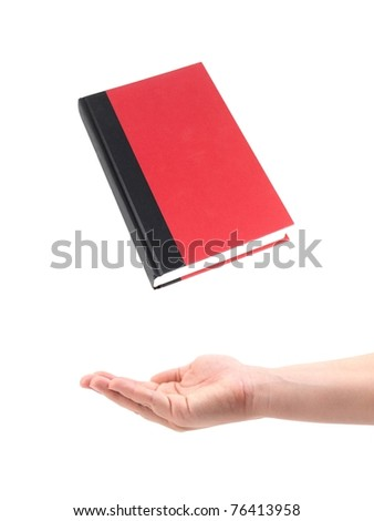 A red book and a hand isolated against a white background - stock photo