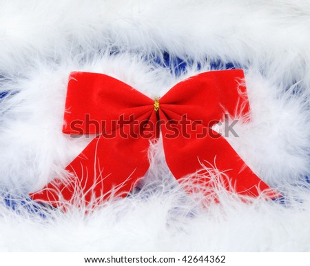 A red bow on the swan's down - stock photo