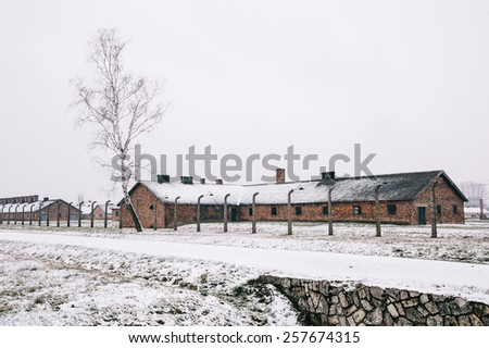A red brick house in the snow covered concentration camp of Auschwitz  Birkenau, Poland - stock photo