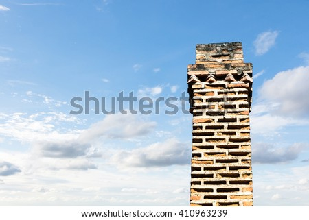 A red brick masonry chimney on a residential home.. isolated background sky. with Clipping Path - stock photo