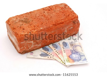 A red brick with four notes of South African one hundred Rand notes isolated on white background - stock photo