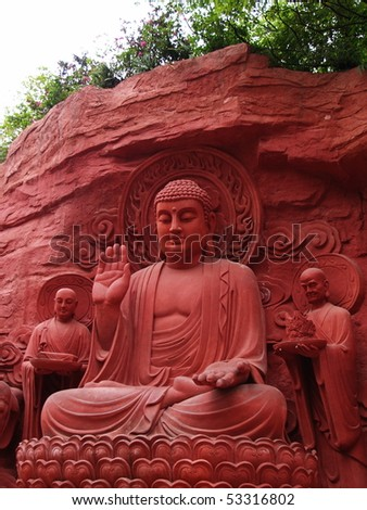 A Red Buddha with servants - stock photo