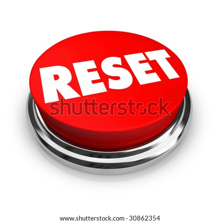 A red button with the word Reset on it - stock photo