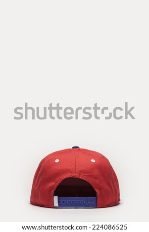 A red cap back side view isolated white background. - stock photo