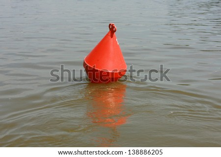 A red channel marker guides boats through the water, buoy for a boat - stock photo