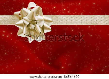 A red Christmas present with a gold bow and ribbon, merry Christmas
