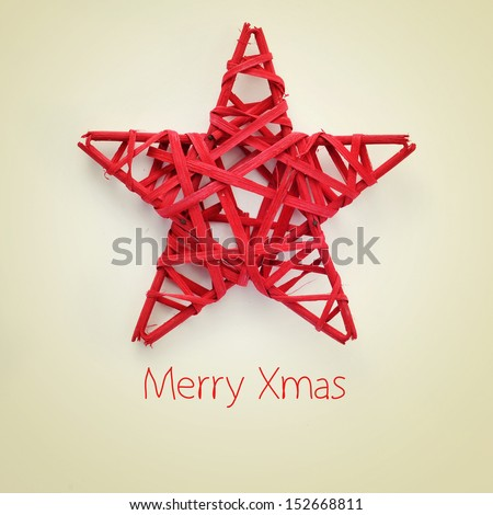 a red christmas star and the sentence merry xmas on a beige background, with a retro effect - stock photo
