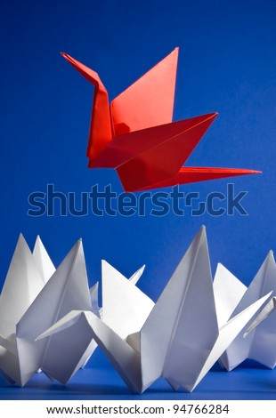 A red crane rising above the crowd - stock photo
