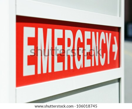 A red Emergency sign at the entrance to a hospital - stock photo