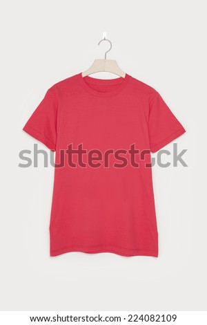 A red empty t-shirts front side with wooden hanger isolated white background.