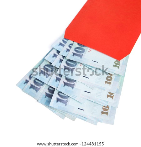 A red envelope filled with 1000 New Taiwan dollar notes isolated on a white background. - stock photo