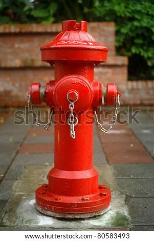 a red fire plug/ fire plug - stock photo