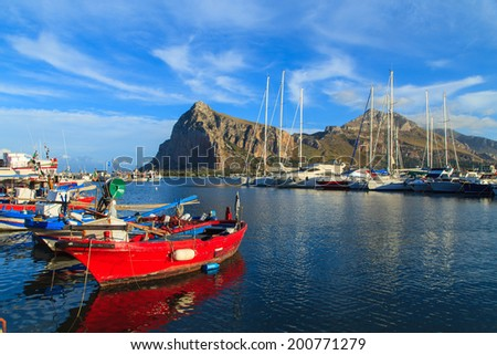 A red fishing boat in a port in San Vito Lo Capo, Sicily, Italy - stock photo