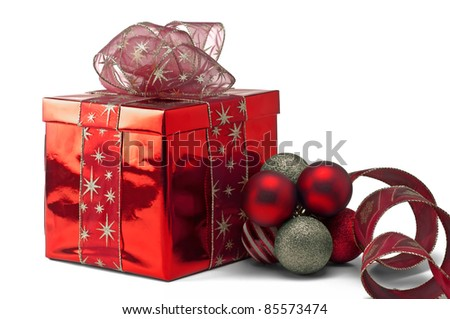 A red gift box with Christmas decorations - stock photo