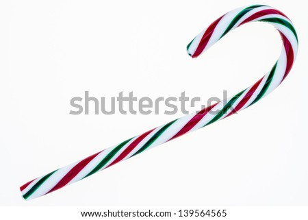 A red, green and white candy cane isolated on a white background. - stock photo
