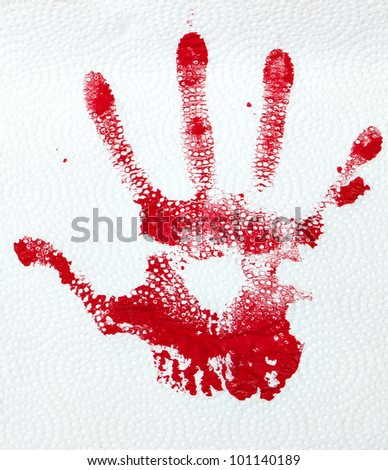 A red hand print on textured paper towlel. - stock photo