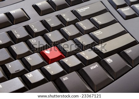 A red heart key on a black computer keyboard - stock photo
