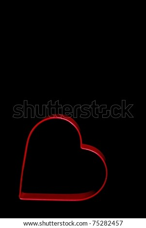 A red heart on a black background - stock photo