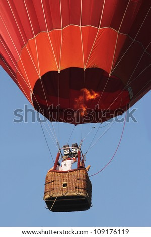 A red hot air balloon - stock photo