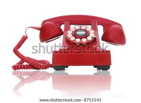 A red hot-line phone over a white background - stock photo