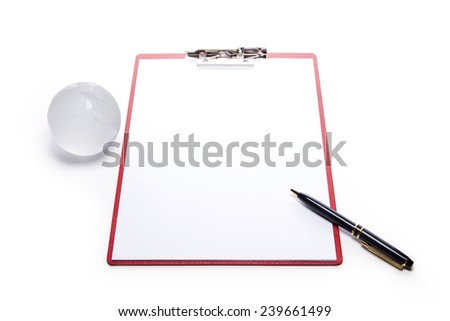 A red leather clipboard with a4 paper and fountain pen and glass globe isolated white at the studio. - stock photo