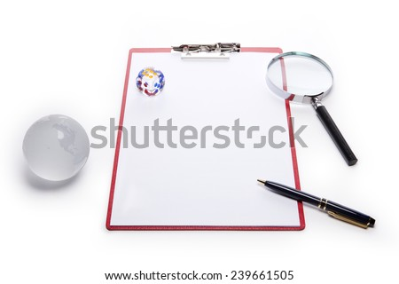 A red leather clipboard with a4 paper and fountain pen and reading glass(magnifying glass[lens], magnifier) and dice and glass globe isolated white at the studio. - stock photo